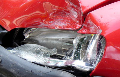 broken headlight on red vehicle