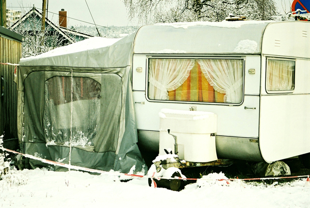 camper parked in the snow