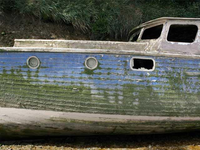 worn boat with broken window