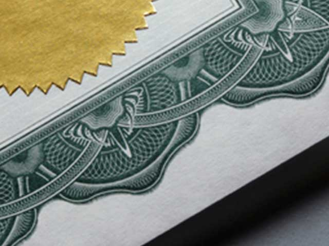 corner of certificate with small part of gold seal showing