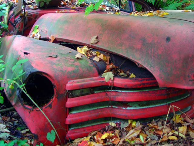 junk red classic vehicle