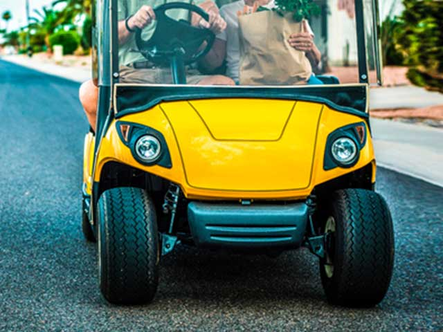 front of yellow golf cart style vehicle