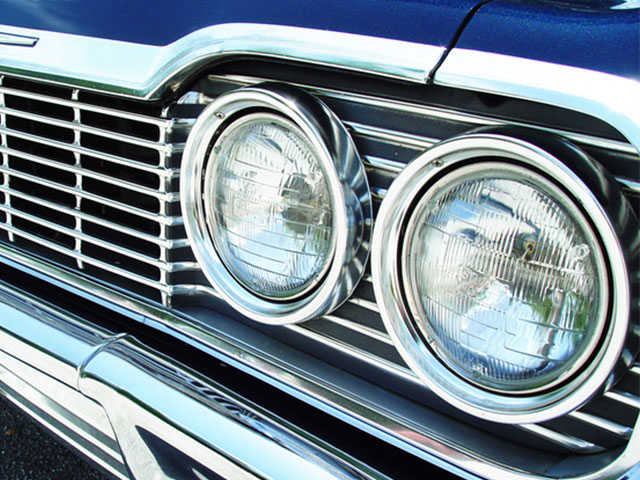 headlights and grill on front of classic car