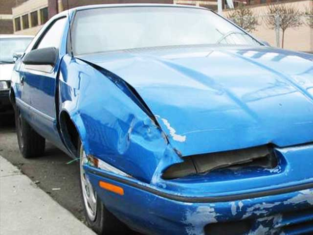front of blue sports car with some visible damage