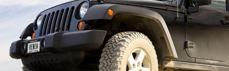 "black jeep with ""RENEW"" Nebraska license plate"