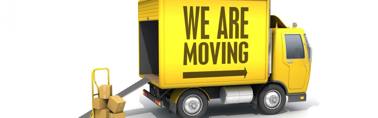"Picture of a yellow moving truck with the text ""We are Moving"" on the side."