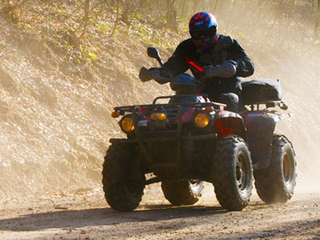 person on 4-wheeler on a dirt road