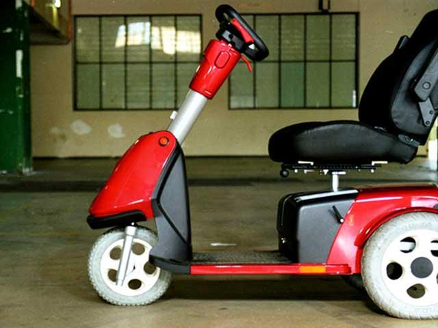 side view of a motorized scooter