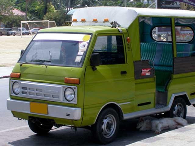 front of green foreign minitruck