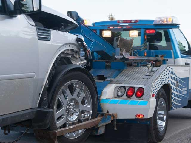vehilce being towed behind a tow-truck